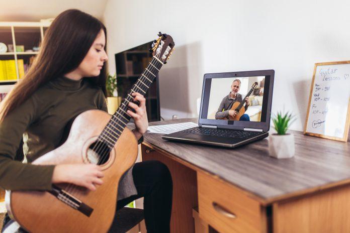 School Salute_USE_bigstock-Focused-Girl-Playing-Acoustic--360112042 (1)-68c45d6b