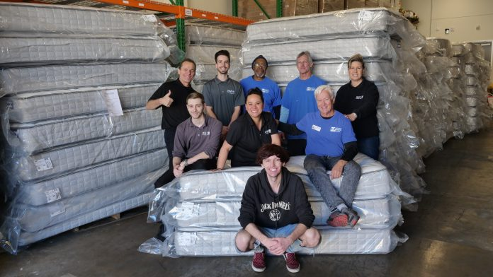 Living Spaces team celebrate with Arizona Helping Hands staff-b6164cc0