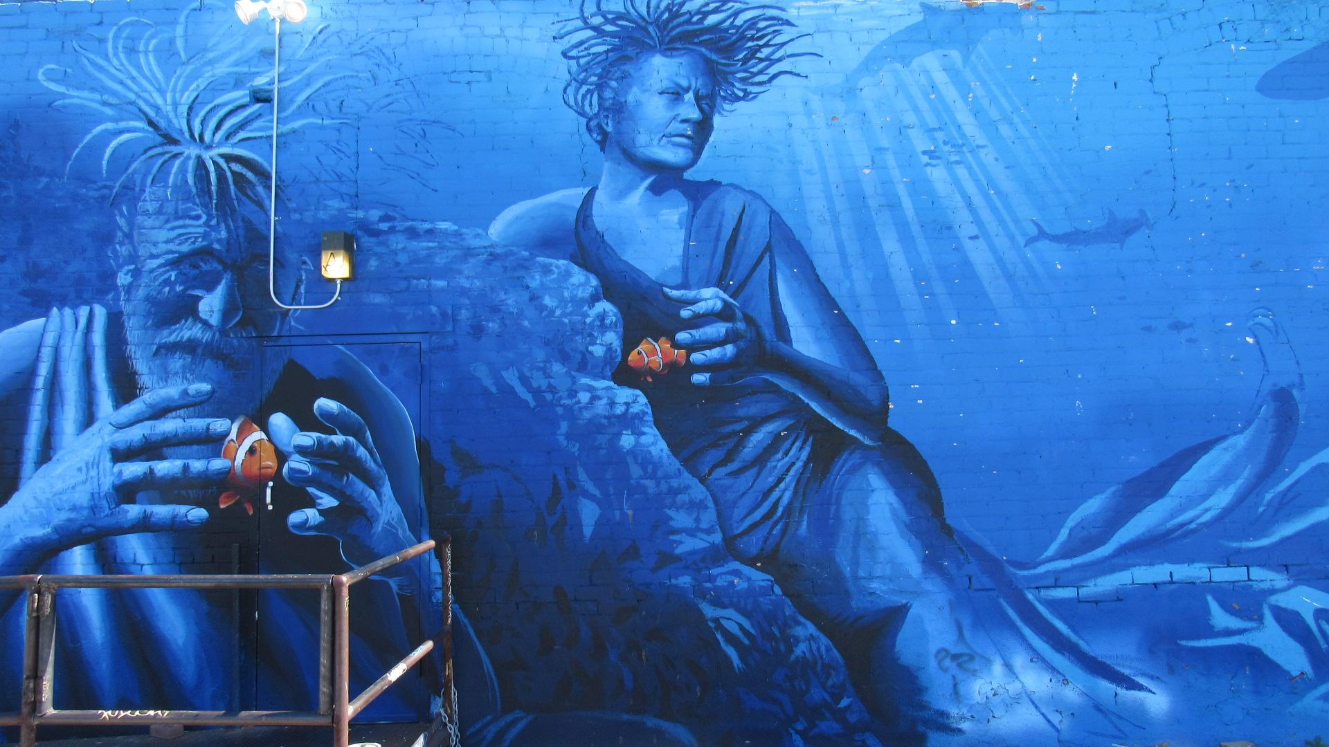 The man behind the mural joe pagac my local news us for Mural joe painting